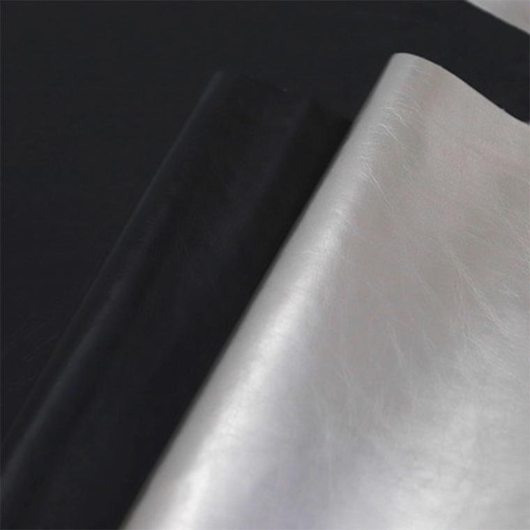 厂家现货镜面揉纹包装革PU材质眼镜箱包革粗布底