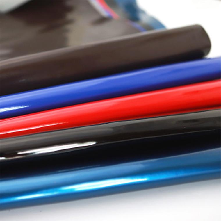 厂家现货供应镜面革PU材质TC布手提袋眼镜包装革